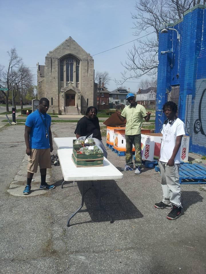Anthony Beauford, center, at the Central Detroit Christian food distribution site.
