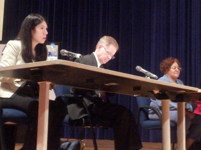DPS EM Steven Rhodes, center, takes notes at a meeting with Detroit's elected school board.
