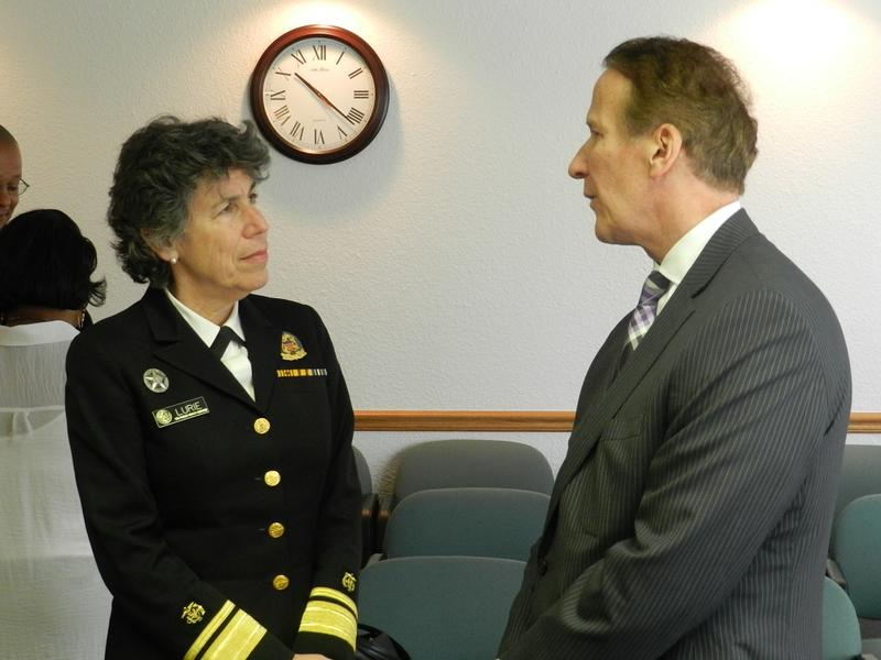Dr. Nicole Lurie (left) speaks with officials of the Genesee Health System