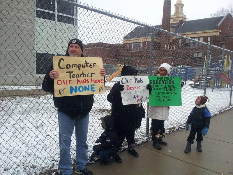 Parents protest outside a Detroit elementary school earlier this year.