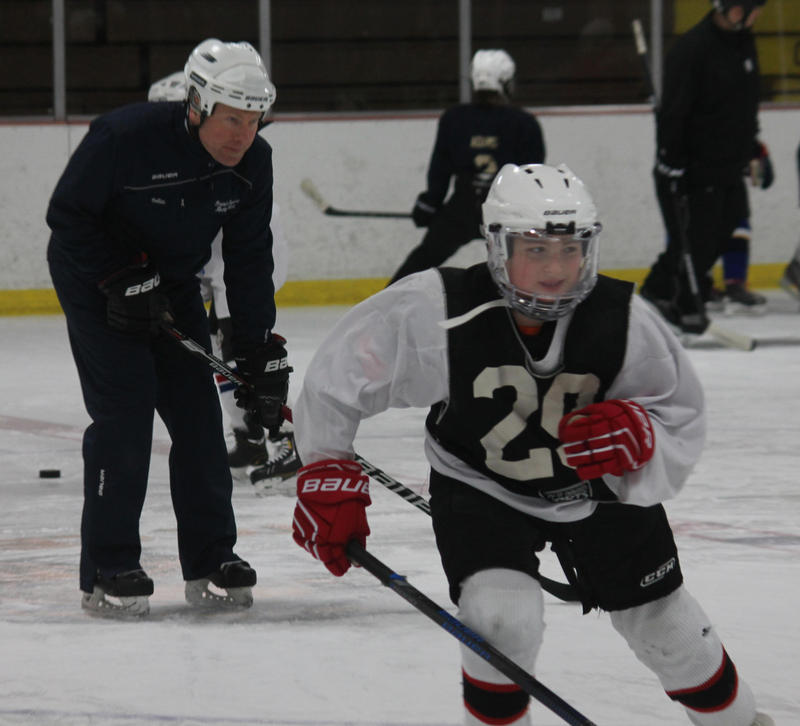 Joshua Groves does a drill at Howe Area in Traverse City with coach Jason Gollan in the background. Practice has become the core of many youth hockey programs nationwide as the sport has elevated development over competition.