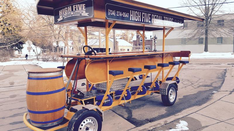 "One of the High Five Pedal Tours trolleys. Patrons sit on the side and pedal while a ""driver"" steers and operates the brakes."