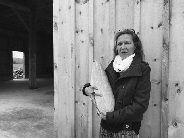 Punkin Shananaquet, a member of the Gun Lake tribe, holds a Gete Okosman squash at the Gteganes Farm.
