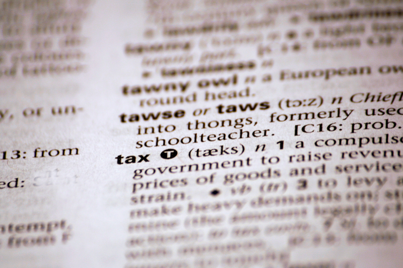 dictionary definition of tax