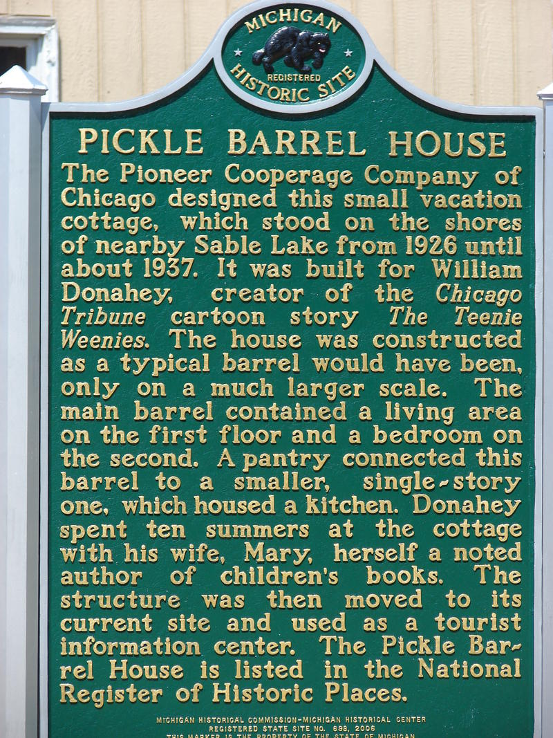 This plaque stands next to the Pickle Barrel House's current location in Grand Marais, Michigan.