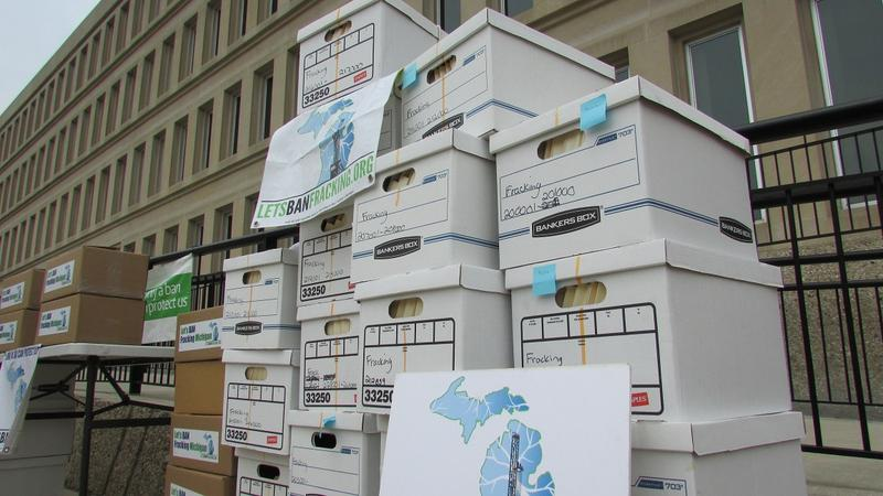Boxes of petition signatures are piled up in front of the Michigan Secretary of State's office