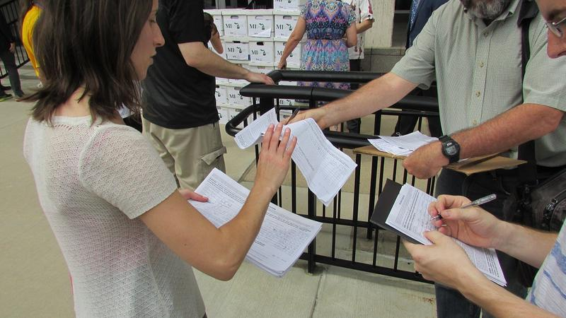 Signatures were still coming in as the MI Legalize campaign dropped off boxes of petitions at the state election office.