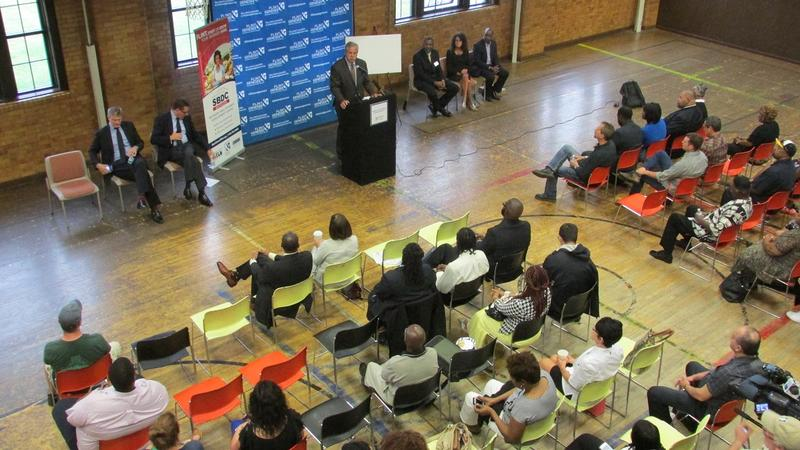 The grants were announced during an event at Flint's Berston Field House