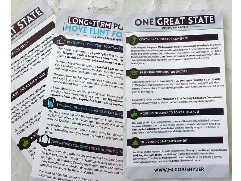 "Governor Snyder has been handing out cards that highlight ""how far we've come & the work that still needs to be done."""