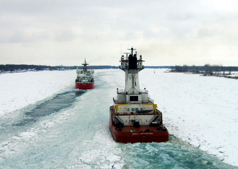 The crew of Coast Guard Cutter Mackinaw and the crew of tug Joyce L. Van Enkevort cut through the ice as they escort motor vessel Algoway through the southeast bend in the lower St. Clair River near Harsens Island, Feb. 2, 2014.