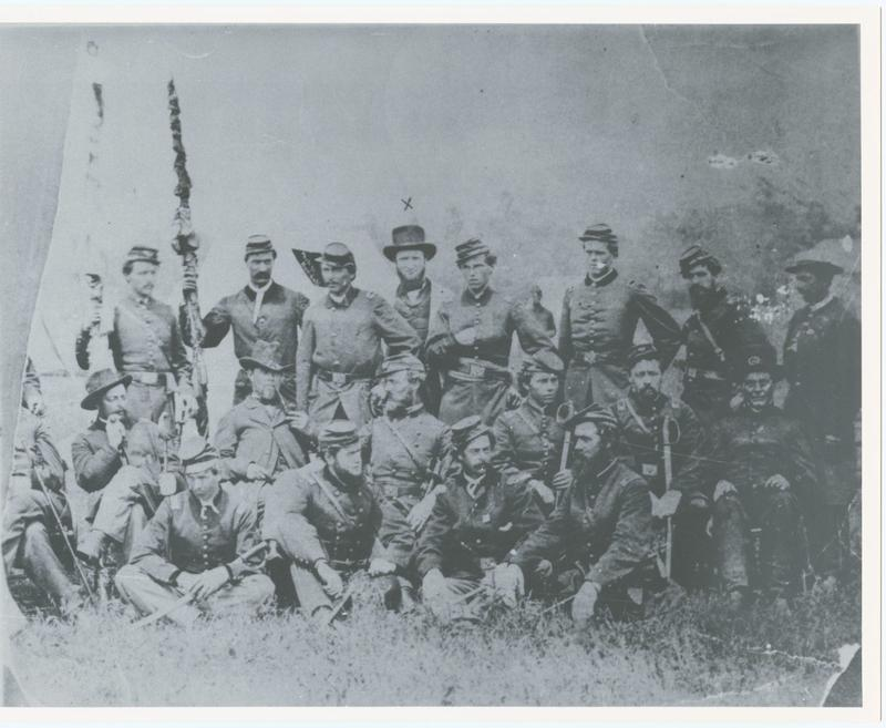 The officers of the 17th Michigan Volunteer Infantry Regiment in camp at Grass Lake, Michigan. They carry furled flags.