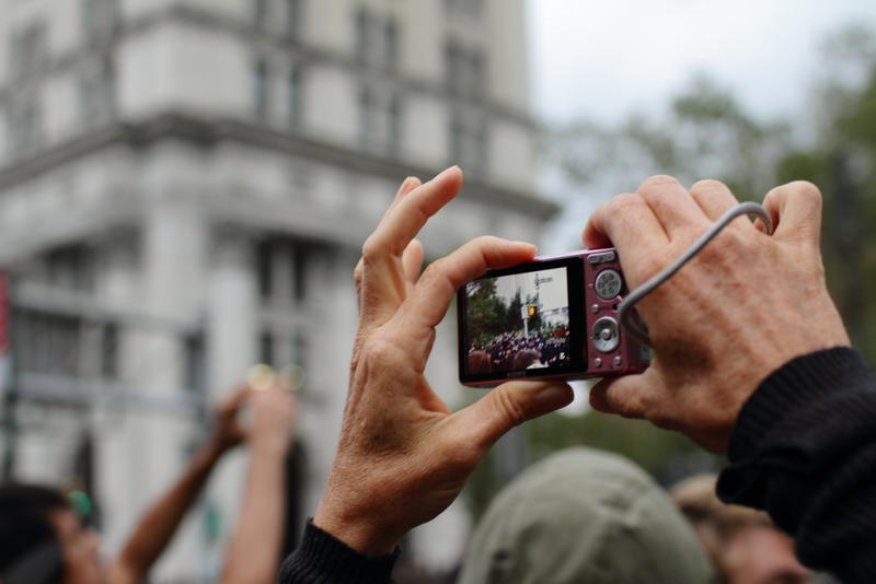 An Occupy Wall Street protester records police in 2011.