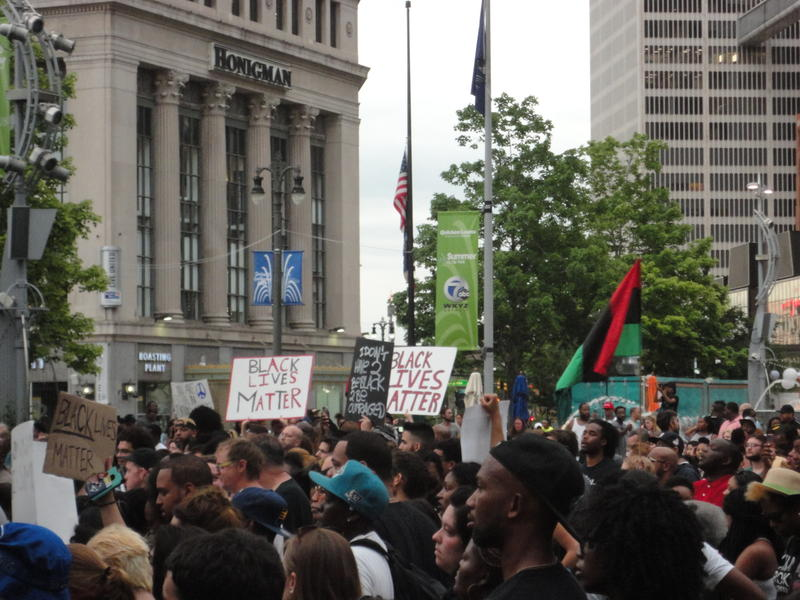 Demostrators in downtown Detroit protest police-involved shootings that have killed African-Americans.