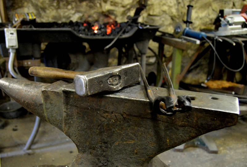 The anvil, hammer, and tongs in front of the Waterloo Metal Works forge.