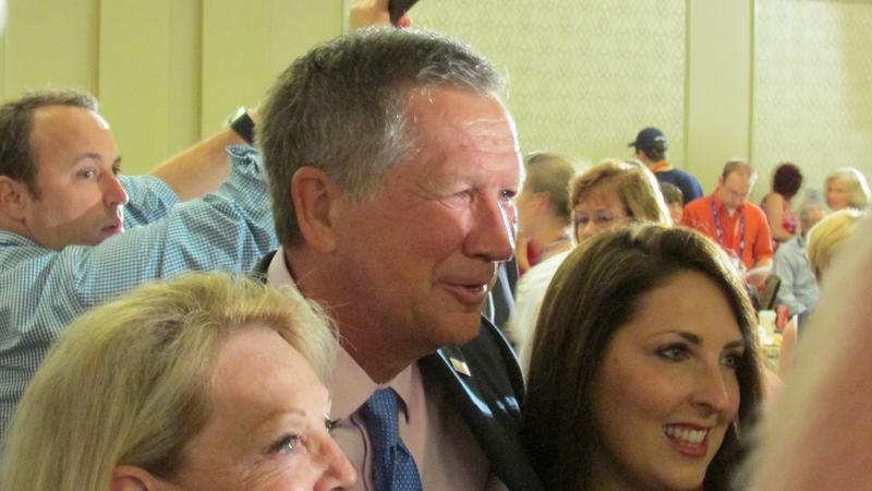 Gov. John Kasich, R-OH, posed for photos with Michigan delegates after their morning meeting in Akron.