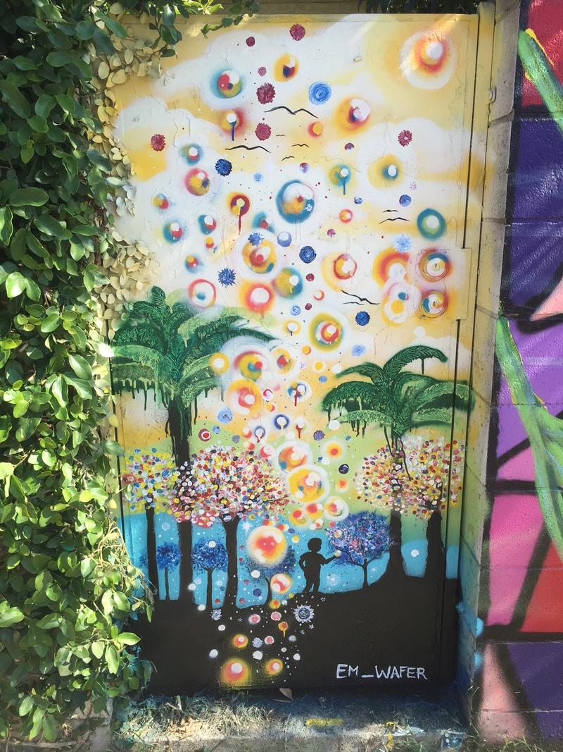 Mural by artist em_wafer