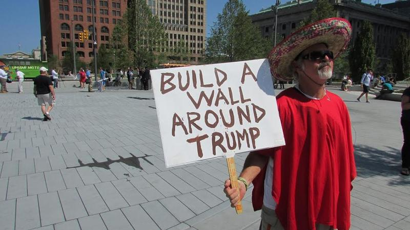 A protester holds an anti-Donald Trump sign outside the Republican National Convention in Cleveland on Monday.
