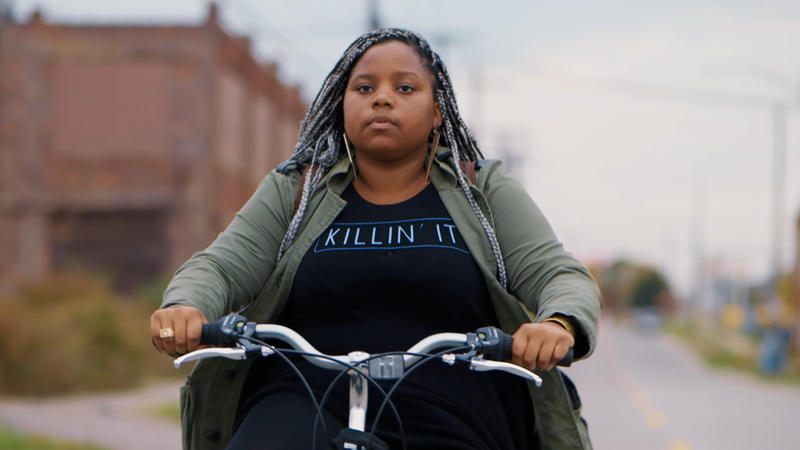 Mason employee Dextina Booker riges her bike through Detroit