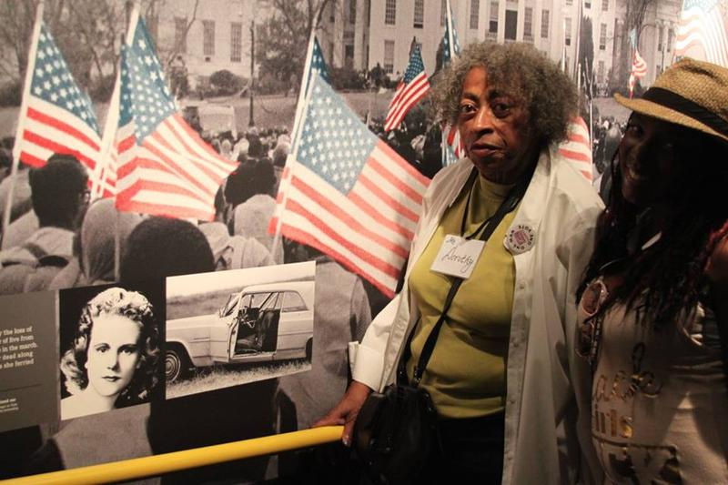 Dorothy Aldridge and Sylvia Morgan in front of an exhibit at the National Civil Rights Museum​ in Memphis​ showcasing Detroit activist Viola Liuzzo, who was murdered by the Ku Klux Klan while driving black voting rights activists between Selma and Montgom