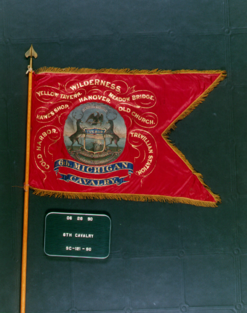 A flag of the Sixth Michigan Volunteer Cavalry Regiment. The regiment was part of the Michigan Cavalry Brigade, composed of the 1st, 5th, 6th and 7th Michigan Cavalry Regiments. It was commanded by General George Armstrong Custer.