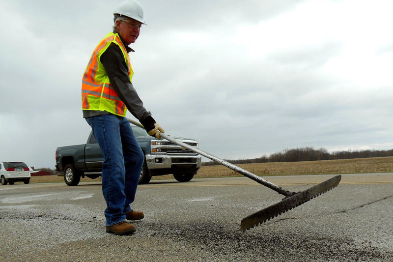 Governor Snyder patches potholes on M-37.