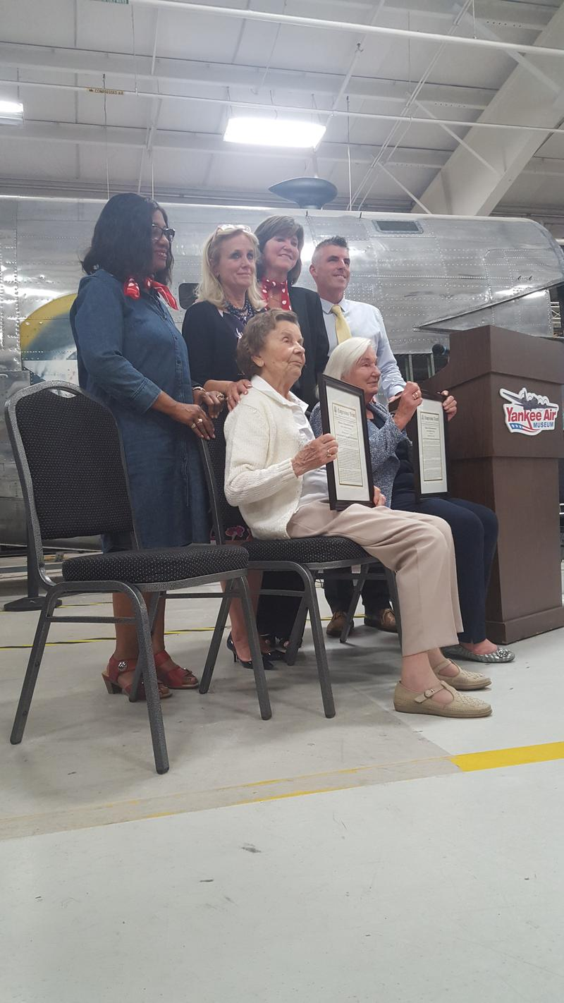 Phyllis Roullier and Mary Jezowski-Serge receive honorary awards for their work at the Willow Run Bomber plant during WWII