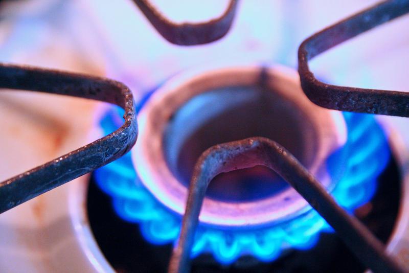Natural gas stove top burning