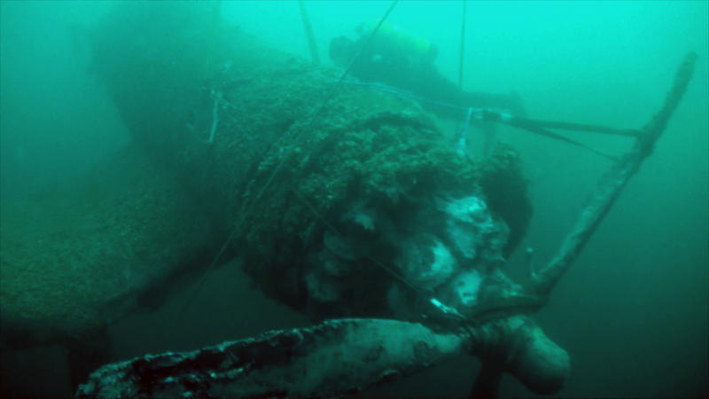 Divers explore the wreckage of a World War II plane in Lake Michigan.