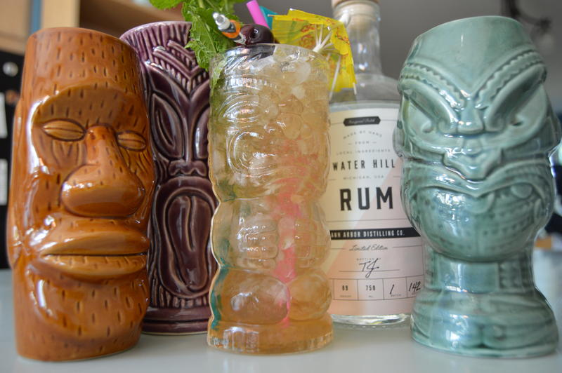 Many Tiki establishments serve cocktails in Tiki mugs like these.