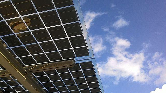 Double glass photovoltaic solar modules, installed in a support structure.