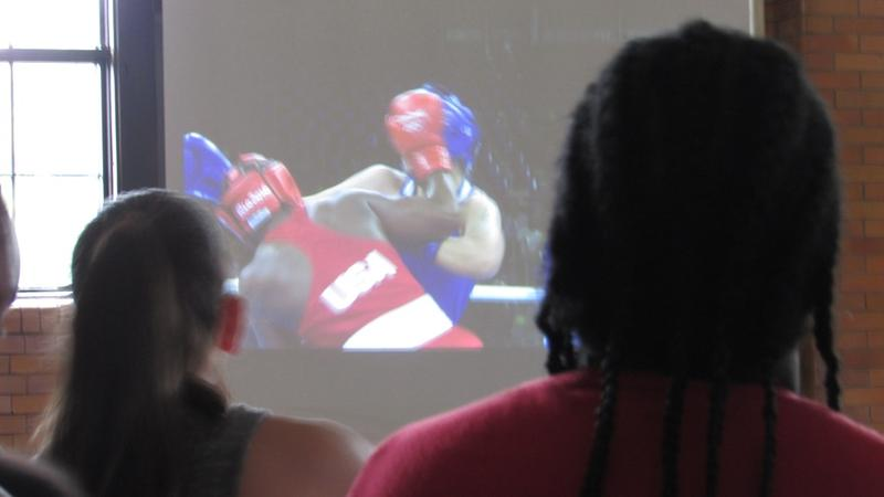 Flint residents paused today to watch local boxer Claressa Shields take to the ring at the Rio Olympics.
