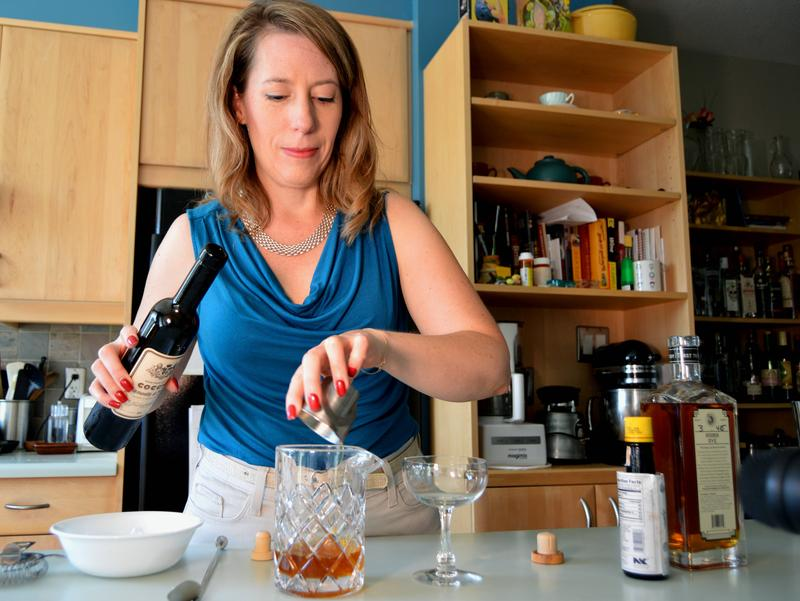 Tammy Coxen mixes a Manhattan. She'll use brandied cherries she made at home. Recipes below.