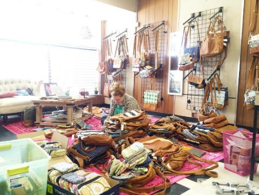 Founder Rebecca Smith prepares for a warehouse sale.