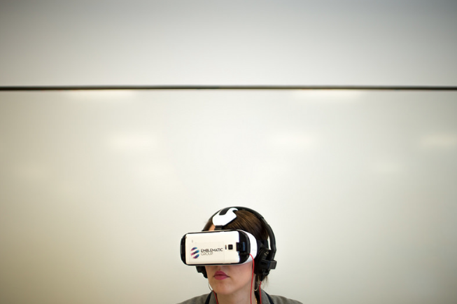 A Grand Rapids therapist is using virtual reality technology to help his patients confront traumatic environments.