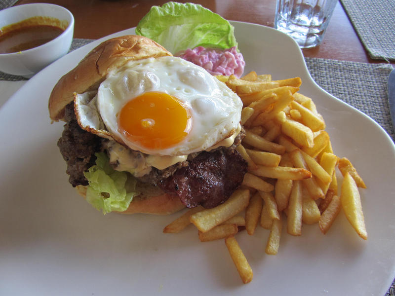 Burger with a fried egg on top.