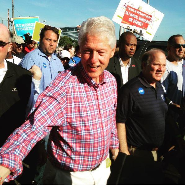 Former President Bill Clinton marches in Detroit's Labor Day parade.