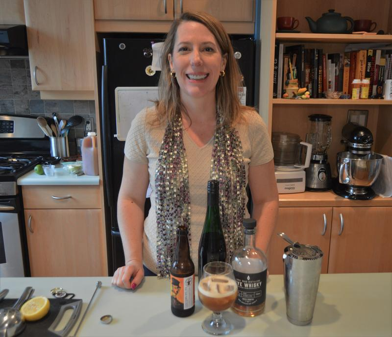 Tammy Coxen of Tammy's Tastings just finished mixing the Sawbuck.