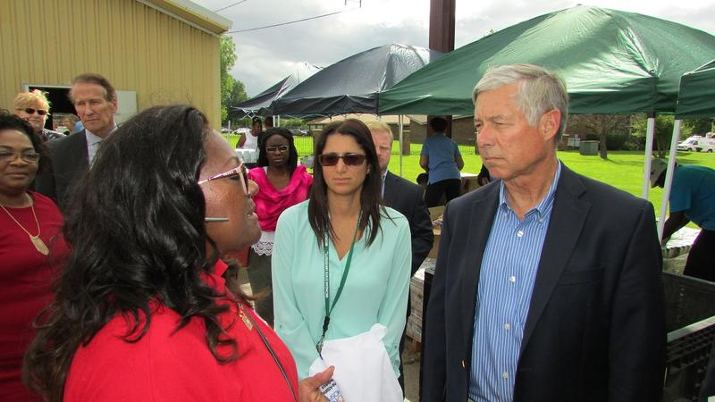 U.S. Rep. Fred Upton (R-St. Joseph) stopped by a water distribution center in Flint.