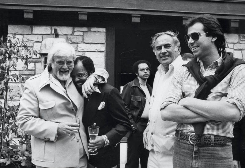 Barney Ales and Berry Gordy with music merchants Milt and John Salstone during a party at Gordy's home in Los Angeles, March 1977.