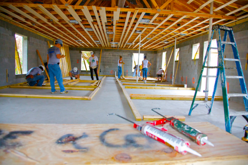 After dealing with pay decreases and increased health insurance and pension costs, teacher Jeff Smith was chosen for a Habitat for Humanity House.