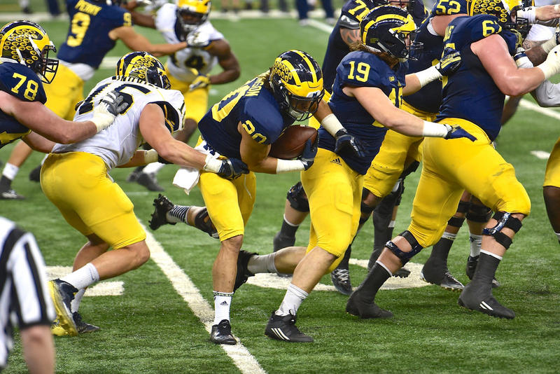 Michigan football players practice in the spring of 2016 at Ford Field.