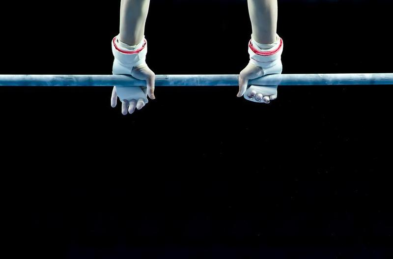 gymnast hands on bar