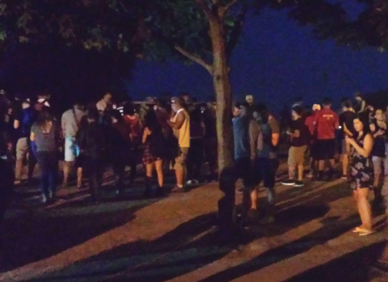 "Crowds of ""Pokémon GO"" players gather for some late night monster hunting in this park in Vancouver."