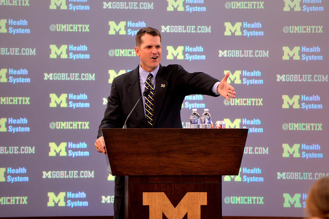 jim harbaugh at podium