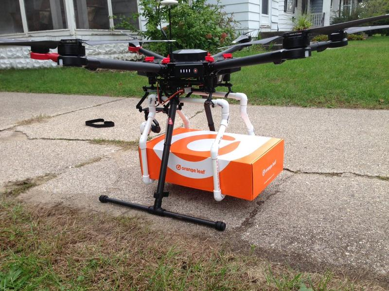 Drone holding box of frozen yogurt treats.