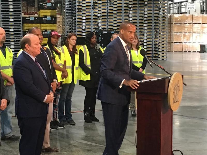U.S. Assistant Commerce Secretary Jay Williams, right, and Detroit Mayor Mike Duggan at the LINC Logistics facility.