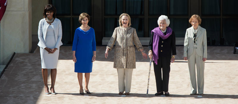 First Ladies Michelle Obama, Laura Bush, Hillary Clinton, Barbara Bush and Rosalynn Carter stand during dedication of the George W. Bush Presidential Library and Museum in 2013.