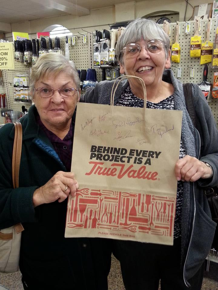 Some customers take a signed souvenir from Hoekstra's True Value Hardware during the sale this week.
