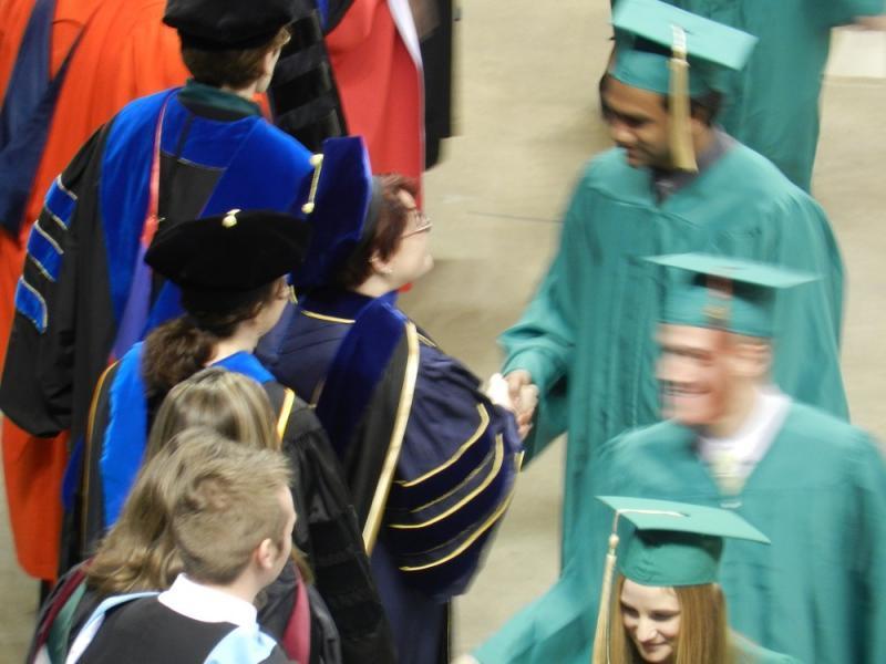 graduates in a line