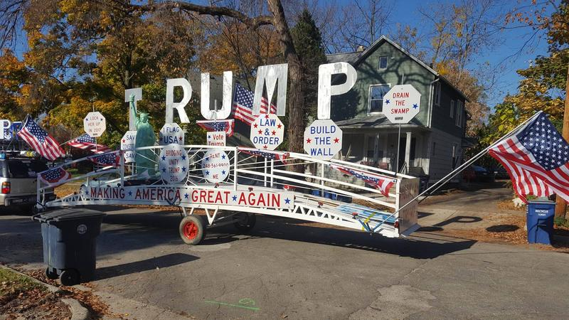 "A photo of a Trump supporter's trailer-parade float called ""The Unity Bridge"" to showcase his support for Donald Trump, taken a few blocks from where Barack Obama was speaking."